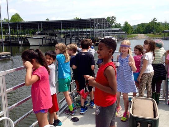 Kids on a Blue Heron harbor cruise get a fun look at