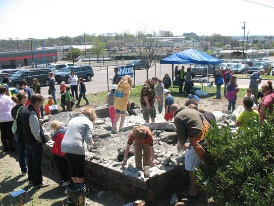 Kids and adults enjoying the fossils dig at Fort Negley.