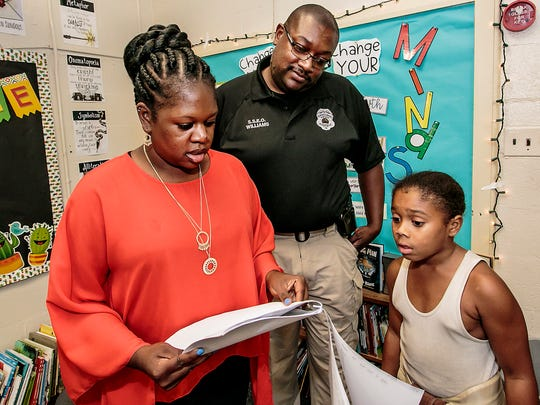Quinena Bell, Assistant Principal at Hobgood Elementary School, left, helps Franky Hathaway find his classroom at the school's open house Thursday evening. Watching is the schools S.S.E.O. Chris Williams.