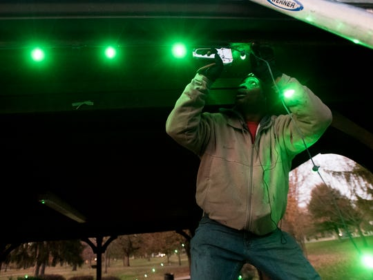 Duane Sykes hangs lights at the picnic areas and gazebos of Yoctangee Park in Chilicothe, Ohio, for the 2017 Christmas season.