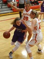 Norwalk senior Keara Schmitt is boxed in by Carlisle