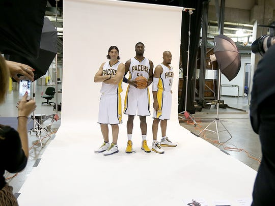 The Indiana Pacers held their media day Monday, September 29, 2014, morning at Bankers Life Fieldhouse. Here Luis Scola,left, Roy Hibbert and David West,right, pose for NBA photographer Ronald Hoskins.