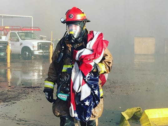 Firefighter saves flag from Phoenix fire; photo goes viral