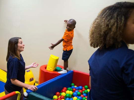 Wesley College Master's of Occupational Therapy 2nd year student Samantha Fulton works with Joey Hampton at the All About Kids Sensory Gym in Middletown. The program offers a student run pro bono clinic to underserved Delaware communities.