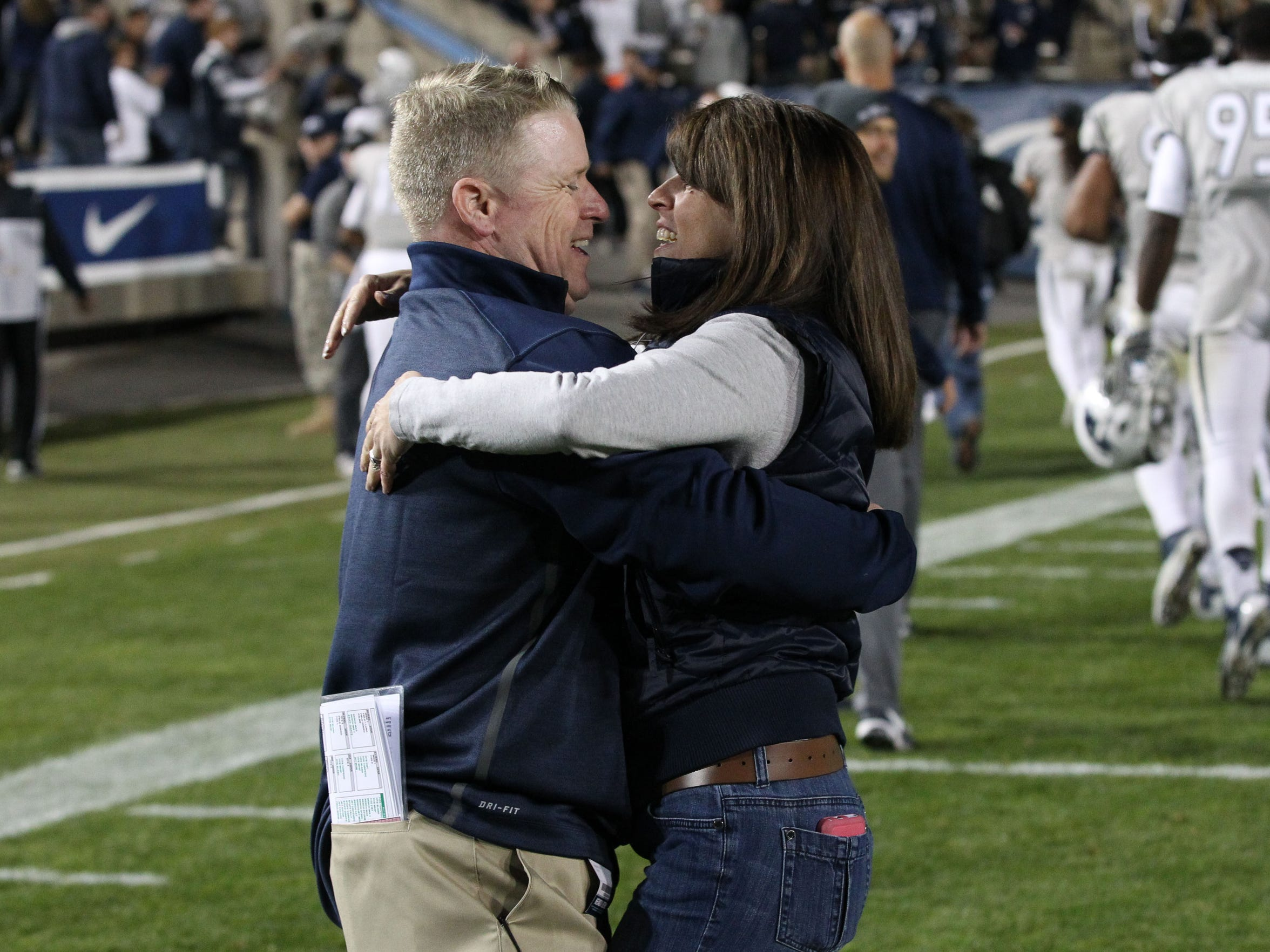 Brian Polian celebrates with wife Laura after Nevada's win over BYU in 2014.