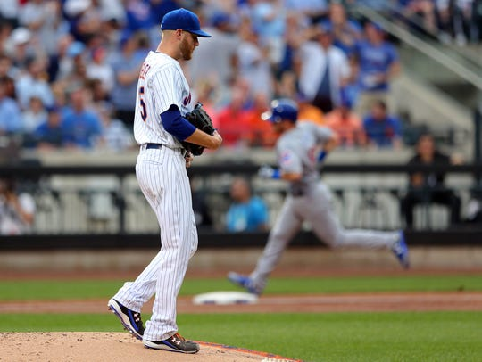 Chicago Cubs second baseman Ian Happ (8) rounds the