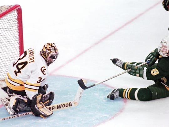Vermont player Martin St. Louis (8) scores a goal against Colorado College goalie Judd Lambert (34) during the second period Friday, March 28, 1996, at the NCAA Frozen Four in Cincinnati.