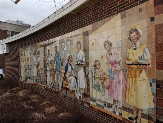 """A 2006 photo of the """"Helping Hands"""" mural by artist"""