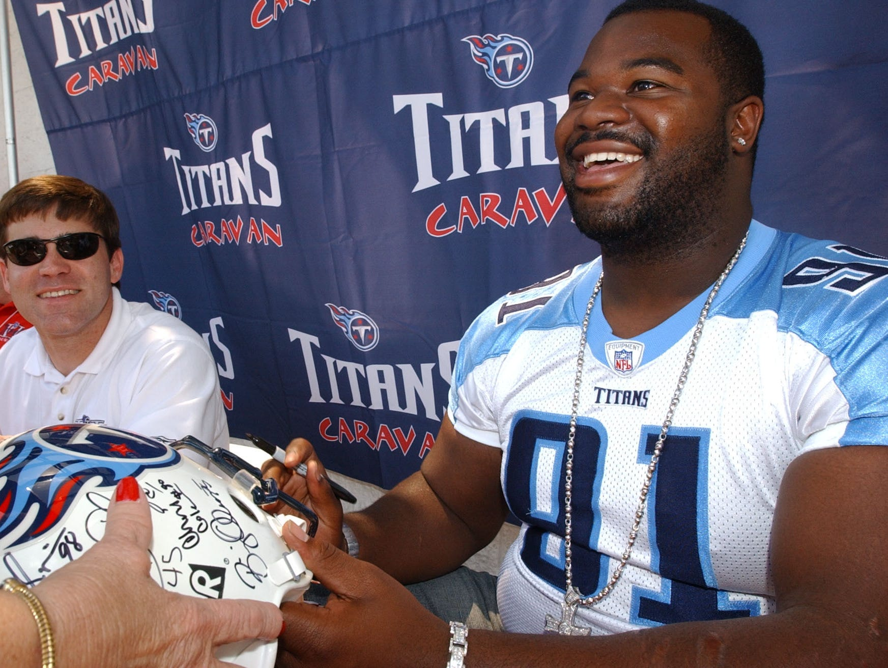 Albert Haynesworth returns a Titan helment to Avanell Robinson during an autograph session in Rockwood in 2003