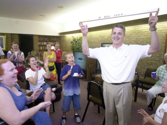 "In June 2002, Dan Tripp holds up "" a big stick "" (in the words of Teddy Roosevelt) that he said he would be taking with him to Columbia after winning re-election to the state House District 28 seat."
