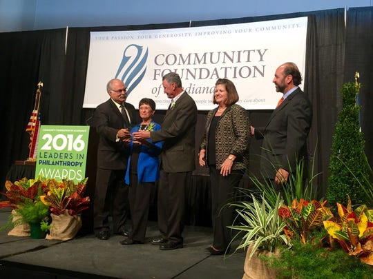 Phil and Renee Haney accept a Leaders in Philanthropy Award from the Community Foundation of Acadiana during a luncheon Friday.