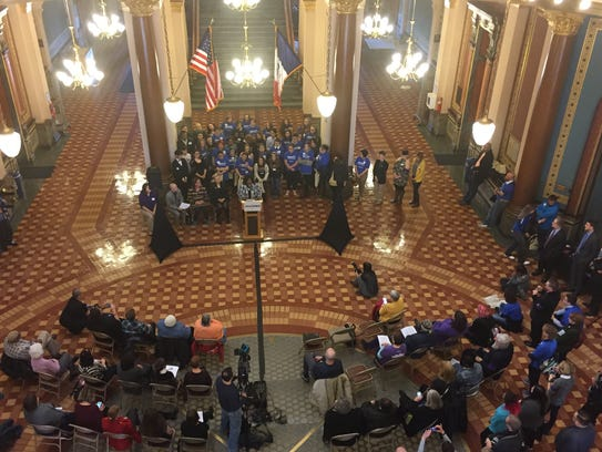 More than 100 people rallied at the Iowa Capitol on