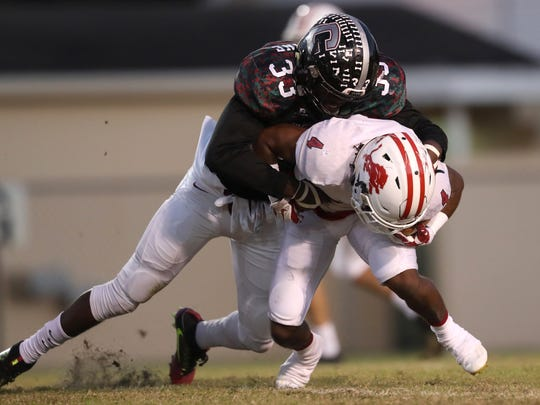 Chiles' Amari Gainer tackles Leon's Queze Brutton during their game at Cox Stadium on Friday, Oct. 27, 2017.
