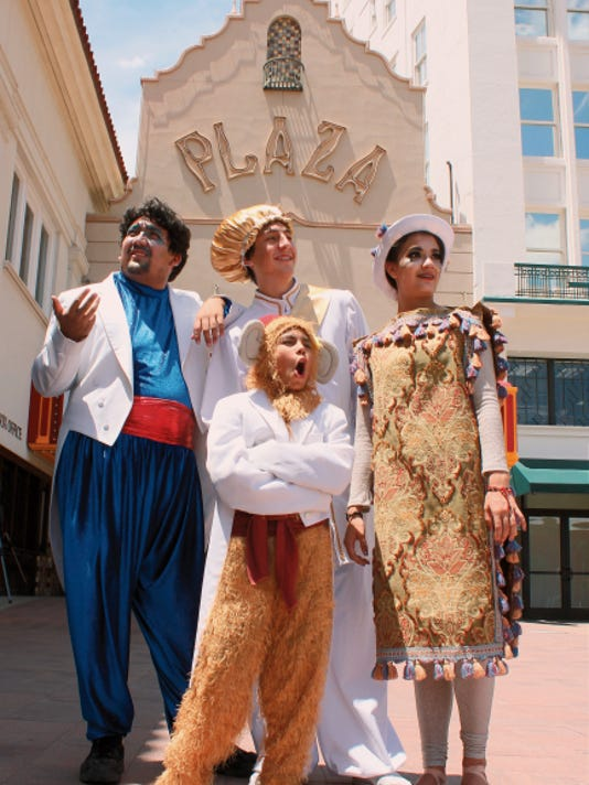 """Members of the cast of Kids-N-Co.'s production of """"Aladdin"""" pose in front of the Plaza Theatre, where the show will be performed Saturday."""