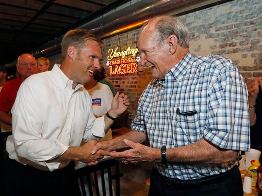 Republican 3rd Congressional District nominee Michael Guest, is congratulated by State Rep. Ray Rogers, R-Pearl, right, at his victory celebration in a Brandon, Miss., restaurant, after defeating Whit Hughes in a runoff, Tuesday, June 26, 2018.