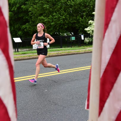 Betsy Eickelberg, of Leonia, races to the finish line