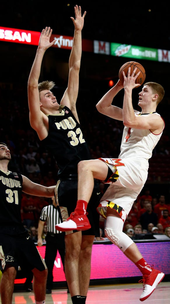Maryland guard Kevin Huerter, right, shoots against