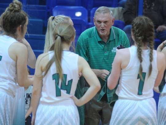 May coach Jeff Blackburn talks to his team during a timeout in the fourth quarter against Roby. The Lady Tigers beat Roby 48-41 in the Region II-1A quarterfinal game Tuesday, Feb. 20, 2018 in Winters.
