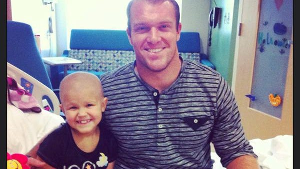"""Colts long snapper Matt Overton is a major supporter of Riley Hospital for Children and its patients. On Feb. 11, Overton posted this photo on Twitter, saying """"A year ago my sweet little buddy Leah got her wings. My thoughts & prayers are always with the Wasson family #Riley."""""""