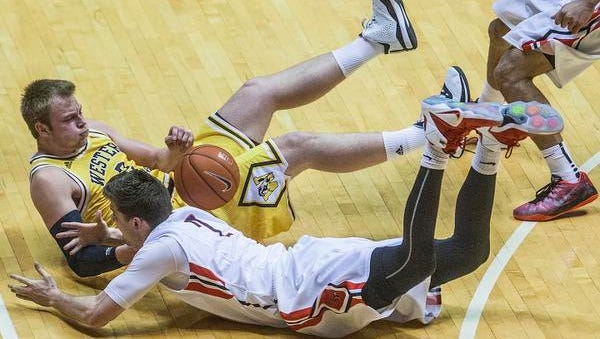 Ball State's Matt Kamieniecki fights for possession against Western Michigan's defense during their game at Worthen Arena Tuesday.