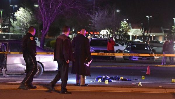 Officers investigate at the scene where an office involved shooting occurred at South McCarran Blvd on Jan. 25, 2016.