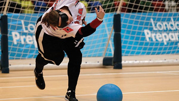 Lisa Czechowski launches the ball during the Paralympic Games in Rio.