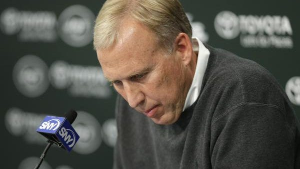 Jets general manager John Idzik pauses during a news conference at the team's training center in Florham Park, N.J., on Monday.