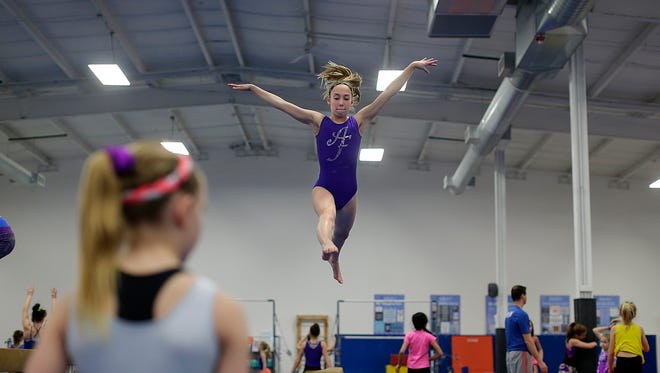 Audra Hayes, 13, does work on the balance beam during class Wednesday at Air Force Gymnastics in Howard.
