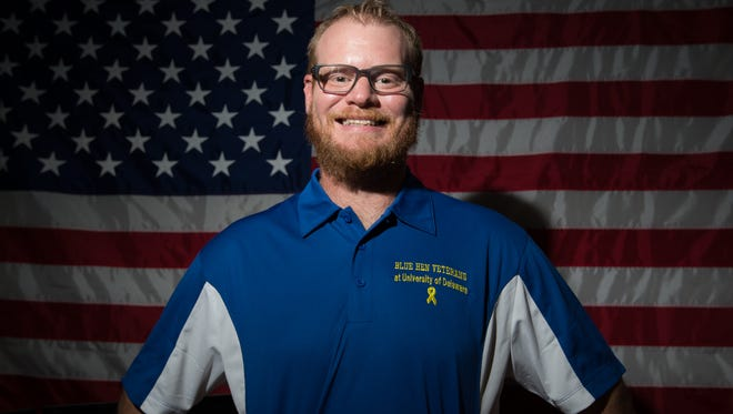 Army veterans, Stephen McGuire, in the Blue Hens Veterans' office at the University of Delaware.  Stephen is a senior at UD studying geography with a concentration in geological information science.