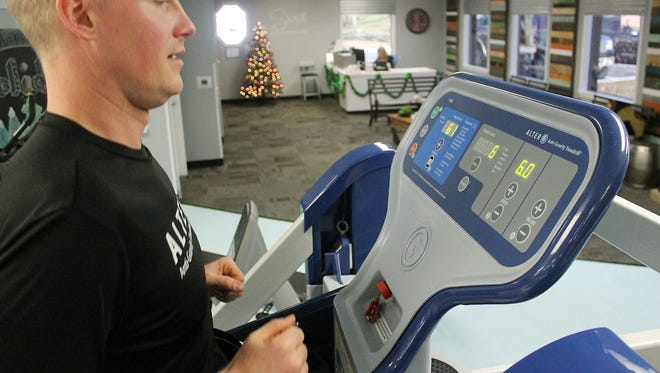 Chris Doemland, wellness program director at Martin Foot and Ankle, lost 70 pounds in a quest to train for a triathlon and recover his past athleticism. After rolling an ankle, he used an AlterG treadmill at the practice to keep training to finish the race.