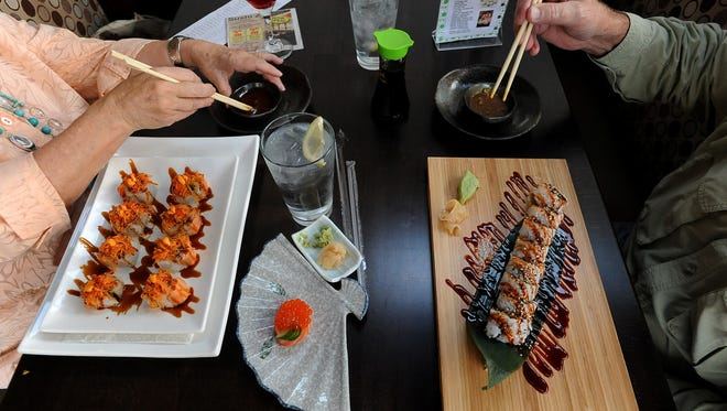 Sushi Zensai customers dine in this Coloradoan file photo. The restaurant announced Friday it was closing its Loveland location. Its restaurant in Old Town Fort Collins remains open.
