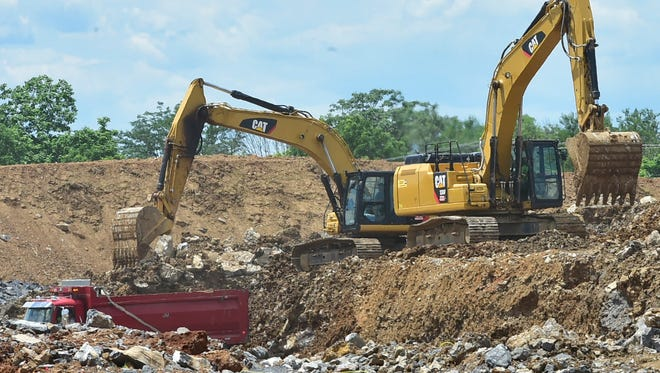 Earth movers are at work at the site of a new warehouse under construction on Monday, June 26, 2017 at WCN Drive off Guilford Springs Road.