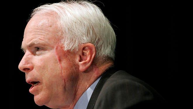 Sen. John McCain, R-Ariz., speaks Oct. 15, 2004, during a debate against Democratic senatorial challenger Stuart Starkey in Tucson, Ariz.