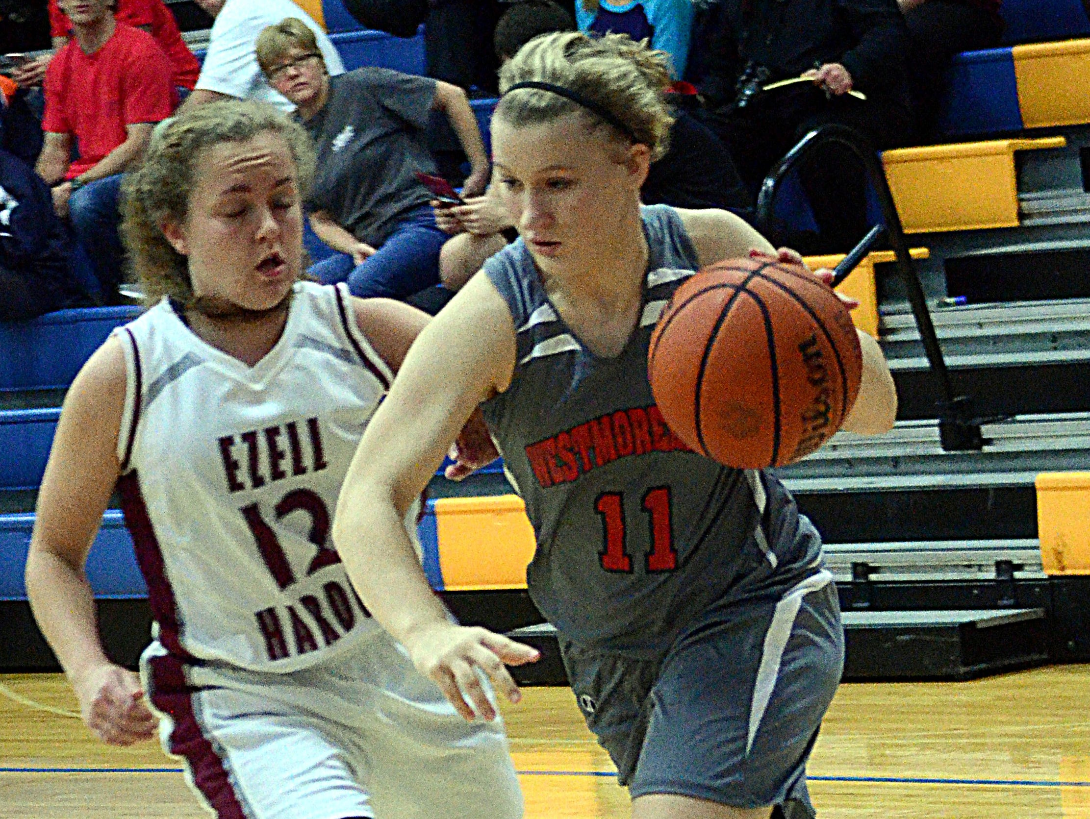 Westmoreland High junior guard Lexie McCormick dribbles along the baseline as Ezell-Harding senior Marci Sneed defends. McCormick scored nine points.