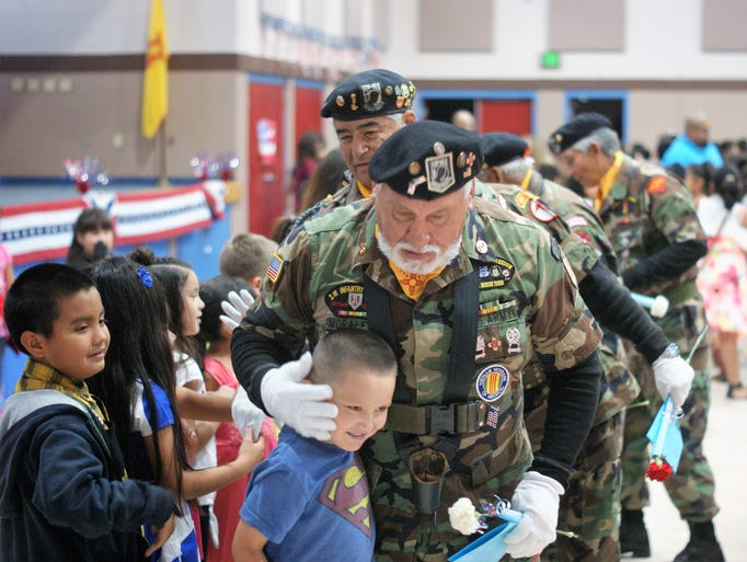 Children greeted members of the Vietnam Veterans of