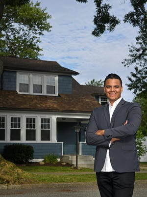 This house, located at 2804 Charlotte Street, in Erie, is shown on July 21. It was recently renovated by Miguel A. Rodriguez, 32, foreground, a local man known for flipping area homes for resale.