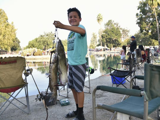 Visalia's Parks and Recreation hosted its annual Summer Catfish Derby for children on Saturday, July 28. Roughly 200 families registered to toss their line into Plaza Park's pond. The fishing derby was divided into two age groups with prizes going to the top three stringer weights in each category.