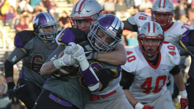 Shelby's area sack leader Derek Rose tackles Lexington's 1,000-yard back Hunter Biddle in a game last fall. They will square off again Saturday night as two of the marquee names in the NCOFCA All-Star Classic at Arlin Field.