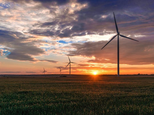 WEC Energy Group will have invested more than $1.2 billion in wind farms in the Midwest with the purchase announced Monday.