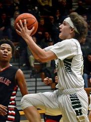 Howell's Josh Palo drives to the basket against Grand