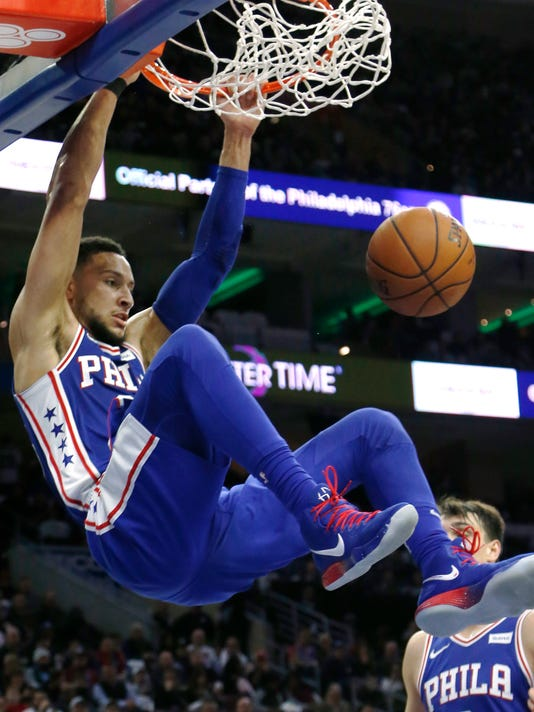 Philadelphia 76ers guard Ben Simmons dunks during the second half on the team's NBA basketball game against the Chicago Bulls, Wednesday, Jan. 24, 2018, in Philadelphia. The 76ers won 115-101. (AP Photo/Laurence Kesterson)