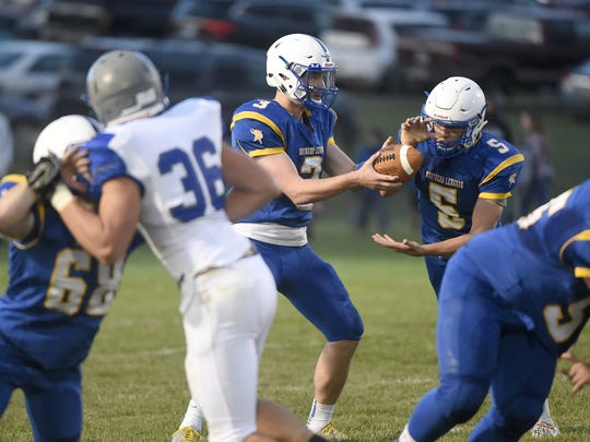 Northern Lebanon's Stevie Herb takes the handoff from quarterback Michigan Daub during a game against Cedar Crest earlier this season. The Vikings head to Donegal for a key Section 3 battle on Friday night.
