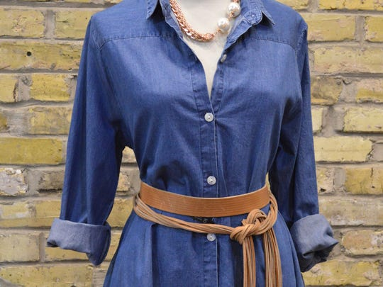Chambray or denim, like this derss from Lela Boutique, transitions well from summer to fall. Add a belt and leggings to a chambray shirt or dress for a fall look.