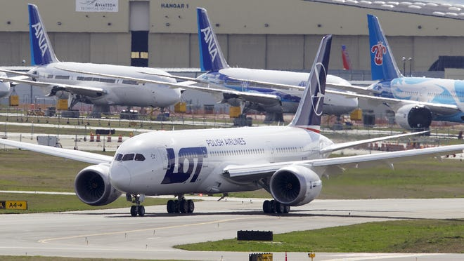 A LOT Polish Airlines Boeing 787 Dreamliner taxis after a certification flight April 5, 2013, at Paine Field in Everett, Wash.