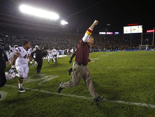 Todd Graham runs onto the field at the Rose Bowl after