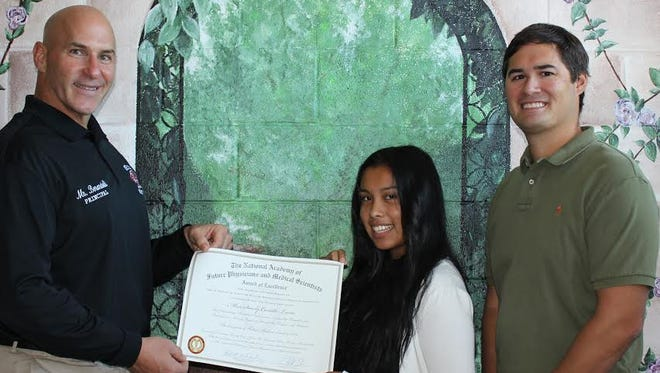 Sandy Castillo-Luna, a sophomore at Delsea Regional High School, attended the National Academy of Future Physicians and Medical Scientists in Boston during the summer. Recently, Paul Berardelli (left), principal, Delsea Regional High School, presented her with the Award of Excellence for her participation in this prestigious program, as Tim Keck, Castillo-Luna's guidance counselor, looked on.