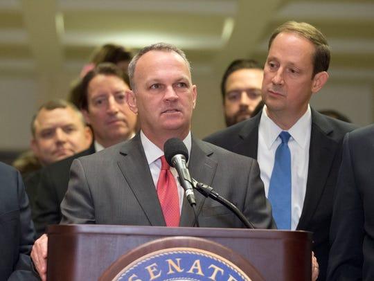 Florida Speaker of the House Richard Corcoran, left,
