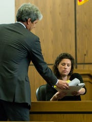 Defense attorney John Day shows witness Audra Davie