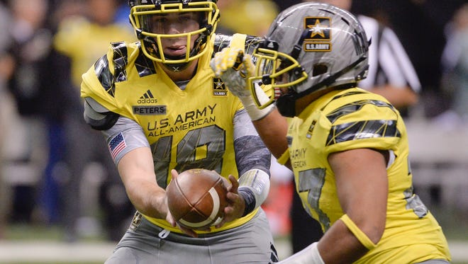 West quarterback Brandon Peters, left, hands off to West running back Vavae Malepeai during the second half of the Army All American Bowl high school football game against the East, Saturday, Jan. 9, 2016, in San Antonio. West won 37-9. (AP Photo/Darren Abate)