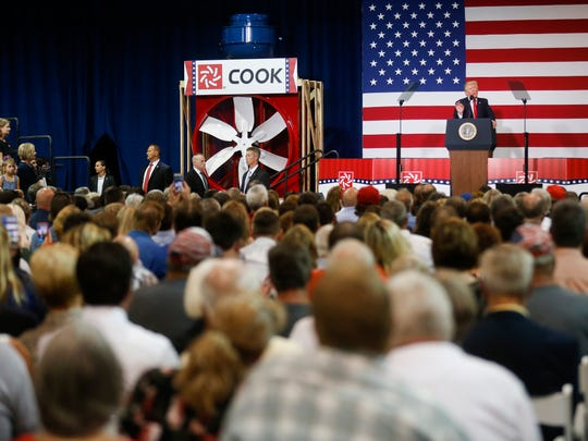 President Donald Trump speaks at the Loren Cook Company